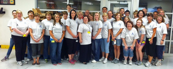 WTB employees sorting food at Second Harvest.